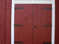 New Barn in Traditional Style with Black Strap Hinges on Swinging Doors