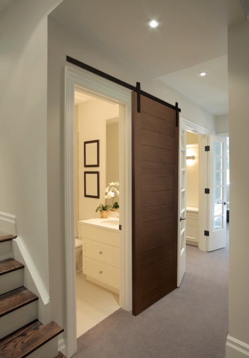 How to expand small spaces with sliding doors rw hardware for Bathroom door ideas for small spaces