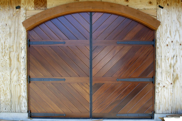 remodel your garage with rustic hardware and door systems